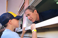 04 Jul 1999, New Hampshire, USA --- Republican presidential candidate George W Bush takes a food order from a child at an ice cream stand on July 4th in New Hampshire. | Location: Amherst, NH.  --- Image by © Brooks Kraft/Corbis