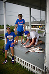 Ozzy Hoffman, Seth Borne, and Shawn Cheramie of Gulf Meadows, LA show off several fish that they had caught earlier in the day.  The Deepwater Horizon spill has led to closures of several of the area's most productive fisheries.  ..Photographs from Grand Isle and surrounding areas impacted by the Deepwater Horizon Oil Spill.  The spill is estimated to be gushing 35,000 to 60,000 barells of oil into the ocean per day.  Difficulties installing monitoring devices at the source have made this number difficult to clearly ascertain.  The spill is among the world's worst.