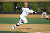 Nate Mondou (10) of the Wake Forest Demon Deacons heads back to first base during the game against the Miami Hurricanes at Wake Forest Baseball Park on March 21, 2015 in Winston-Salem, North Carolina.  The Hurricanes defeated the Demon Deacons 12-7.  (Brian Westerholt/Four Seam Images)