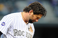 12 JUNE 2010: Colorado Rockies first baseman Todd Helton reacts after being tagged out at third base during an interleague regular season Major League Baseball game between the Colorado Rockies and the Toronto Blue Jays at Coors Field in Denver, Colorado.  *****For Editorial Use Only*****