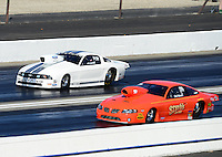 Nov. 10, 2012; Pomona, CA, USA: NHRA pro stock driver Steve Kalkowski (near lane) races alongside J.R. Carr during qualifying for the Auto Club Finals at at Auto Club Raceway at Pomona. Mandatory Credit: Mark J. Rebilas-