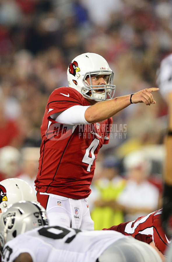 Aug. 17, 2012; Glendale, AZ, USA; Arizona Cardinals quarterback (4) Kevin Kolb calls a play in the second quarter against the Oakland Raiders during a preseason game at University of Phoenix Stadium. The Cardinals defeated the Raiders 31-27. Mandatory Credit: Mark J. Rebilas-