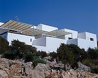 This house built on Ibiza's craggy north coast overlooks the Mediterranean