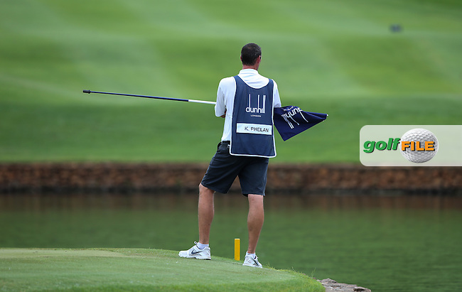 Kevin Phelan (IRL) caddie Steve looks across to the 18th green from the 9th during the Final Round of the Alfred Dunhill Championship 2013 at Leopard Creek, Malelane, South Africa. Picture:  David Lloyd / www.golffile.ie