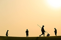Caddie Phil 'Wobbly' Morley holds the flag during the first round of the NBO Open played at Al Mouj Golf, Muscat, Sultanate of Oman. <br /> 15/02/2018.<br /> Picture: Golffile   Phil Inglis<br /> <br /> <br /> All photo usage must carry mandatory copyright credit (&copy; Golffile   Phil Inglis)