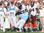 09 September 2006: Virginia Tech's David Clowney (87) is tackled by North Carolina's Jacoby Watkins (16). The University of North Carolina Tarheels lost 35-10 to the Virginia Tech Hokies at Kenan Stadium in Chapel Hill, North Carolina in an Atlantic Coast Conference NCAA Division I College Football game.