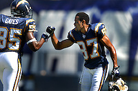 Sept. 17, 2006; San Diego, CA, USA; San Diego Chargers wide receiver (87) Keenan McCardell celebrates with tight end (85) Antonio Gates against the Tennessee Titans at Qualcomm Stadium in San Diego, CA. Mandatory Credit: Mark J. Rebilas