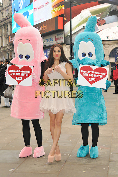 Lacey Banghard .At a PETA Photocall for there Cat and Dog cant use condoms Campaign, Piccadilly, London, England..22nd January 2013 .full length cats dogs can't use condoms spay neuter beige dress costume pink blue.CAP/WIZ.© Wizard/Capital Pictures.