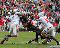 Purdue wide receiver Keith Smith is brought down by Ohio State defenders Jermale Hines (left) and Devon Torrence (10). The Purdue Boilermakers defeated the Ohio State Buckeyes 26-18 at Ross-Ade Stadium, West Lafayette, Indiana on October 17, 2009..