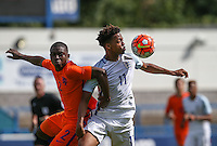 Chris Willock of England beats Sherel Floranus of Holland in the air during the International match between England U19 and Netherlands U19 at New Bucks Head, Telford, England on 1 September 2016. Photo by Andy Rowland.