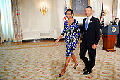 United States President Barack Obama and First Lady Michelle Obama leave the State Dinning Room after signing the Caregivers and Veterans Omnibus Health Services Act, which improve health care services for veterans and expand caregiver benefits and training , in the White House in Washington, DC, on Wednesday, May 5, 2010..Credit: Olivier Douliery / Pool via CNP