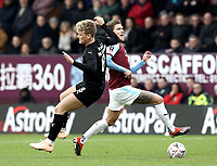 Barnsley's Cameron McGeehan vies for possession with Burnley's Jeff Hendrick<br /> <br /> Photographer Rich Linley/CameraSport<br /> <br /> Emirates FA Cup Third Round - Burnley v Barnsley - Saturday 5th January 2019 - Turf Moor - Burnley<br />  <br /> World Copyright &copy; 2019 CameraSport. All rights reserved. 43 Linden Ave. Countesthorpe. Leicester. England. LE8 5PG - Tel: +44 (0) 116 277 4147 - admin@camerasport.com - www.camerasport.com