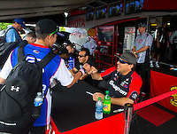 Jun 6, 2015; Englishtown, NJ, USA; A fan spends some one on one time with NHRA funny car driver Cruz Pedregon at an autograph session during qualifying for the Summernationals at Old Bridge Township Raceway Park. Mandatory Credit: Mark J. Rebilas-
