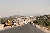 Rajasthan, India. Road from Jodhpur to Jaipur. A large concrete motorway flyover under construction.