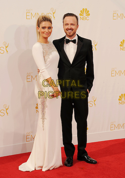 LOS ANGELES, CA- AUGUST 25: Actor Aaron Paul (R) and actress Lauren Parsekian arrive at the 66th Annual Primetime Emmy Awards at Nokia Theatre L.A. Live on August 25, 2014 in Los Angeles, California.<br /> CAP/ROT/TM<br /> &copy;Tony Michaels/Roth Stock/Capital Pictures