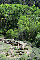 Main Loop trail showing the archeology features along Frijoles Canyon at Bandelier National Monument in New Mexico.  Tyuonyi Pueblo walls