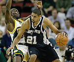 San Antonio Spurs Tim Duncan, R, knocks Seattle SuperSonics Reggie Evans, L, off balance as he moves to the basket in the first period of their  Western Conference Semifinals Game 4 in Seattle, Washington on Sunday, 15 May 2005.   Jim Bryant Photo. ©2010. All Rights Reserved.
