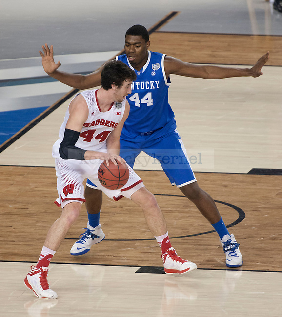 Kentucky Wildcats center Dakari Johnson (44) blocks Wisconsin Badgers forward Frank Kaminsky (44) while he heads to the basket during the NCAA Final Four vs. Wisconsin at the AT&T in Arlington, Tx., on Saturday, April 5, 2014. Photo by Eleanor Hasken | Staff