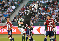 CARSON, CA – June 3, 2011: Chivas USA goalie Dan Kennedy (1) makes a save as teammates defenders Michael Umana and Zarek Valentin (20) look on during the match between Chivas USA and Portland Timbers at the Home Depot Center in Carson, California. Final score Chivas USA 1, Portland Timbers 0.