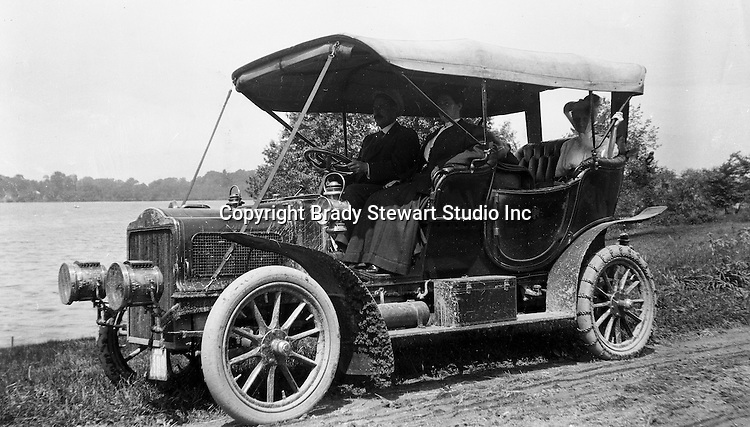 Southwestern Ohio:  Brady Stewart and members of the Brady family driving along the Ohio River in the new Buick Model F - 1906