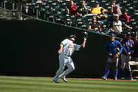 OAKLAND, CA - SEPTEMBER 15:  Jack Cust of the Oakland Athletics catches a fly ball in right field during the game against the Texas Rangers at the McAfee Coliseum in Oakland, California on September 15, 2007.  The Athletics defeated the Rangers 7-3.  Photo by Brad Mangin