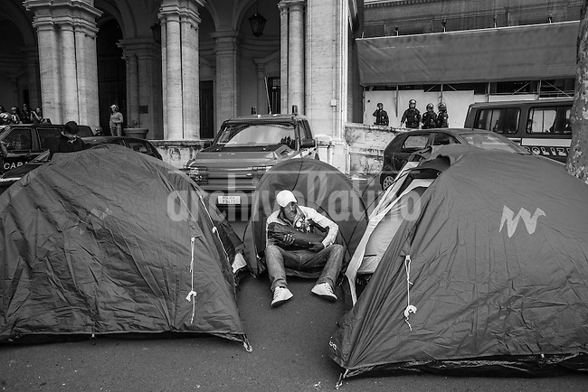 Rome, Italy, may 2013.The protesters reached the headquarters of the Ministry of Infrastructure and plant the tents.Documentary photos on the hundreds of families illegally seizing buldings as squatters due the growing economic crisis in Rome, Italy. This kind of problems in the past were led by inmigrants, but now Italians as well become squatters since housing problems are rampant.