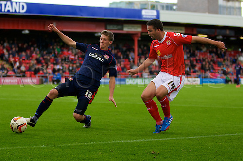 14.09.2013 Crewe, England. Walsall FC defender Paul Downing and Crewe Alexandra Midfielder Bradden Inman in action during the League One game between Crewe Alexandra and Walsall FC from the Alexandra Stadium