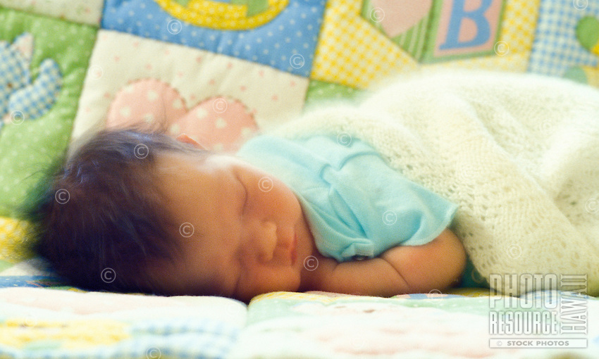 3 month old baby sleeping on a blanket