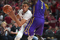 NWA Democrat-Gazette/J.T. WAMPLER Arkansas' Daniel Gafford drives to the basket while Louisiana State's Duop Reath defends Wednesday Jan. 10, 2018 at Bud Walton Arena in Fayetteville. LSU won 75-54.