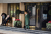 A doorman in uniform outside the Dorchester Hotel in Park Lane, London.