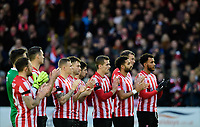 Lincoln City players and fans during a minutes' applause in memory of Kevin Austin<br /> <br /> Photographer Chris Vaughan/CameraSport<br /> <br /> The Emirates FA Cup Second Round - Lincoln City v Carlisle United - Saturday 1st December 2018 - Sincil Bank - Lincoln<br />  <br /> World Copyright © 2018 CameraSport. All rights reserved. 43 Linden Ave. Countesthorpe. Leicester. England. LE8 5PG - Tel: +44 (0) 116 277 4147 - admin@camerasport.com - www.camerasport.com