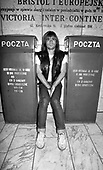 IRON MAIDEN - Bruce Dickinson sitting between two Polish Post boxes in the lower hall of the Hotel Victoria during the start of the World Slavery Tour in Warsaw Poland - August 1984. Photo credit: George Bodnar Archive/IconicPix