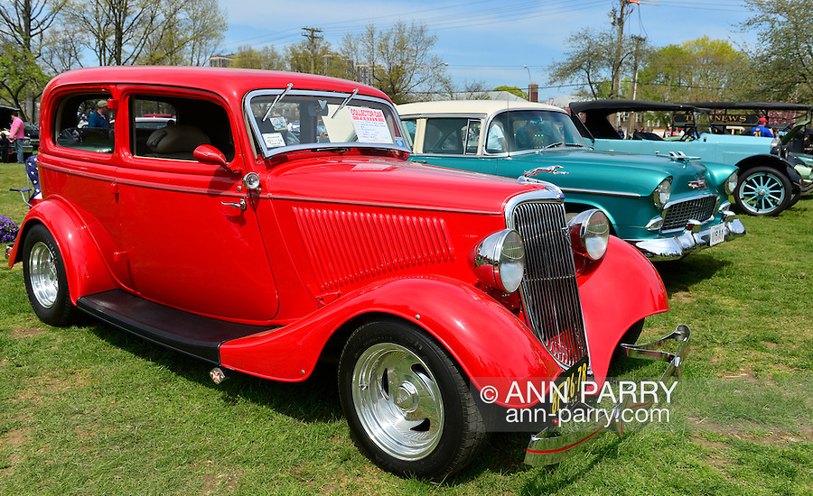 New York Antique Auto Club members exhibit their cars on the farmhouse grounds of Queens County Farm Museum.