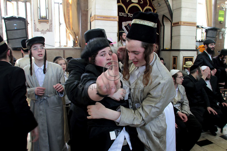 Ultra Orthodox Jews celebrate Purim, in the Orthodox neighborhood of Mea Shearim in Jerusalem  The feast of Purim commemorates the salvation of the Jews from the ancient Persians as described in the book of Esther, celebrations involve participants dressing up in disguises and enjoying otherwise forbidden revelry..Photo (C) Quique Kierszenbaum