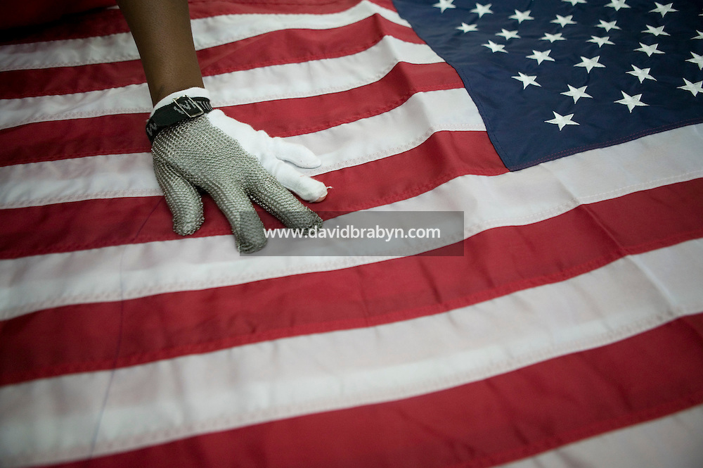 21 June 2005 - Oaks, PA - Shandell Boyd holds down joined American flags before separating them at the Annin & Co. flag manufacturing plant in Oaks, PA. Photo Credit: David Brabyn