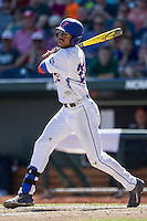 Florida Gators outfielder Buddy Reed (23) follows through on his swing against the Virginia Cavaliers in Game 11 of the NCAA College World Series on June 19, 2015 at TD Ameritrade Park in Omaha, Nebraska. The Gators defeated Virginia 10-5. (Andrew Woolley/Four Seam Images)