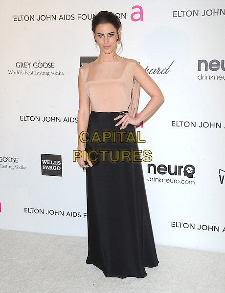 Jessica Lowndes.The 21st Annual Elton John AIDS Foundation Academy Awards Viewing Party held at The City of West Hollywood Park in West Hollywood, California, USA..February 24th, 2013.oscars full length dress beige sheer sleeveless black skirt clutch bag hand on hip.CAP/DVS.©DVS/Capital Pictures.