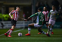 Lincoln City's Harry Anderson vies for possession with  Yeovil Town's Josh Grant<br /> <br /> Photographer Andrew Vaughan/CameraSport<br /> <br /> The EFL Sky Bet League Two - Lincoln City v Yeovil Town - Friday 8th March 2019 - Sincil Bank - Lincoln<br /> <br /> World Copyright © 2019 CameraSport. All rights reserved. 43 Linden Ave. Countesthorpe. Leicester. England. LE8 5PG - Tel: +44 (0) 116 277 4147 - admin@camerasport.com - www.camerasport.com
