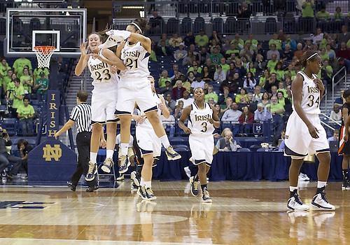 November 20, 2012:  Notre Dame players Michaela Mabrey (23) and Notre Kayla McBride (21) celebrate during NCAA Women's Basketball game action between the Notre Dame Fighting Irish and the Mercer Bears at Purcell Pavilion at the Joyce Center in South Bend, Indiana.  Notre Dame defeated Mercer 93-36.
