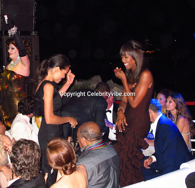 Rosario Dawson and Naomi Campbell..De Grisogno Party..2011 Cannes Film Festival..Eden Roc Restaurant at Hotel Du Cap..Cap D'Antibes, France..Tuesday, May 17, 2011..Photo By CelebrityVibe.com..To license this image please call (212) 410 5354; or.Email: CelebrityVibe@gmail.com ;.website: www.CelebrityVibe.com
