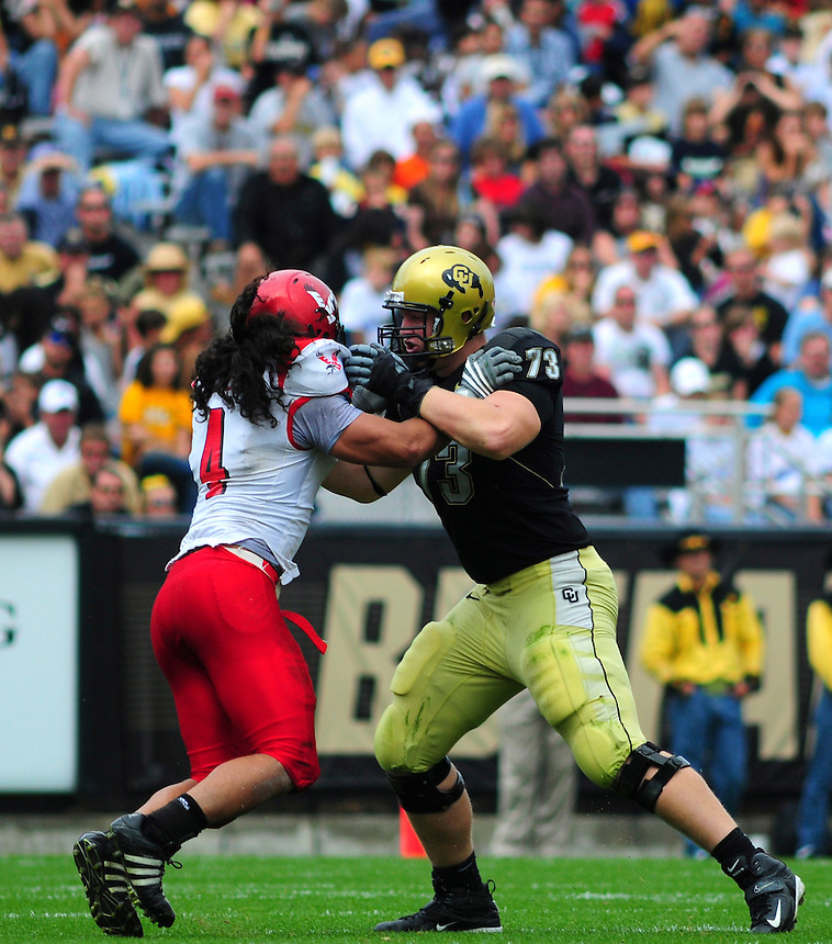 06 September 08: Colorado tackle Ryan Miller (73) ona play against Eastern Washington defensive end Jason Belford. The Colorado Buffaloes defeated the Eastern Washington Eagles 31-24 at Folsom Field in Boulder, Colorado. FOR EDITORIAL USE ONLY