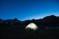 Tent illuminated at night in Ice Lakes Basin, San Juan mountains, Colorado, USA