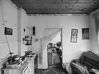 A home in a Roma camp in Tuzla, Bosnia and Herzegovina on October 26, 2008..The Roma population in Bosnia-Herzegovina was heavily affected by the wars in the former Yugoslavia in the early 1990's. It is now estimated at 100,000, but there are no accurate figures, as many are not registered anywhere, either as a result of their own scepticism towards authorities, or due to difficulties in dealing with bureaucratic rules and procedures. Many Roma have no passports, no birth certificates and most importantly, no health insurance. Some aspects of their traditions, culture and lifestyle clash with accepted norms here, as happens elsewhere in Europe. As a result most Roma in the Balkans live in poverty.