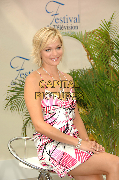 """CRYSTAL ALLEN.Attends a photocall to promote the television series """"Anaconda 3 & 4"""" on the fifth day of the 2008 Monte Carlo Television Festival held at Grimaldi Forum, Monte Carlo, Principality of Monaco, June 12th 2008..half length necklace pink and white print dress sitting .CAP/TTL .©TTL/Capital Pictures"""