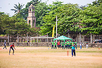 Sri Lankan people playing cricket in front of the Dutch Fort, Negombo, Sri Lanka, Asia. This is a photo of Sri Lankan people playing cricket in front of the Dutch Fort in Negombo, Sri Lanka, Asia.