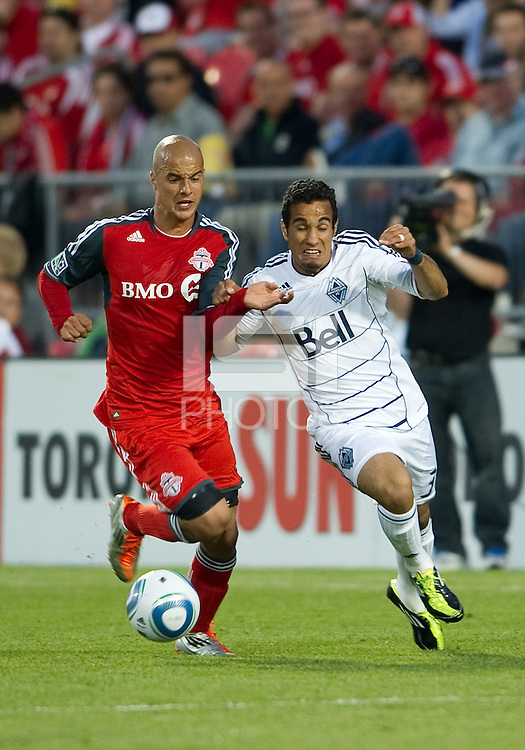 Vancouver Whitecaps FC forward Camilo Sanvezzo #37 and Toronto FC defender Mikael Yourassowsky #19 in action during an MLS game between the Vancouver Whitecaps FC and the Toronto FC at BMO Field in Toronto on June 29, 2011..Toronto FC won 1-0..