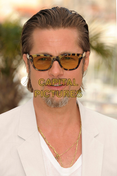 BRAD PITT.'The Tree of Life' photocall at the Palais des Festival, 64th International Cannes Film Festival, France.16th May 2011.headshot portrait white top grey gray beige smiling sunglasses shades tinted goatee facial hair gold necklaces .CAP/PL.©Phil Loftus/Capital Pictures.