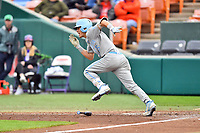 North Carolina Tar Heels left fielder Dylan Enwiller (6) runs to first base after laying down a bunt during a game against the Clemson Tigers at Doug Kingsmore Stadium on March 9, 2019 in Clemson, South Carolina. The Tigers defeated the Tar Heels 3-2 in game one of a double header. (Tony Farlow/Four Seam Images)