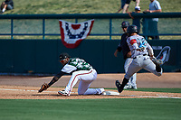 Lake Elsinore Storm first baseman Olivier Basabe (9) prepares to scoop a low throw in front of Alvaro Rubalcaba (12) during a California League game against the Inland Empire 66ers on April 14, 2019 at The Diamond in Lake Elsinore, California. Lake Elsinore defeated Inland Empire 5-3. (Zachary Lucy/Four Seam Images)