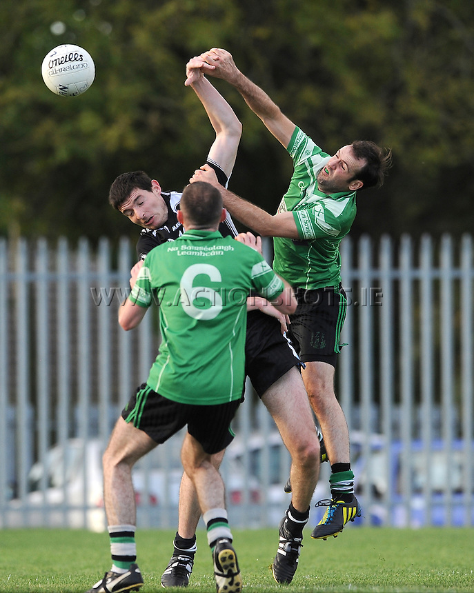 5th October 2013; Roibard MacCarthaigh, St Peregrines, in action against Padraig O'Maoichiarain and Ciaran O'Gallchoir(right) Dublin Senior Football Championship, St Peregrines v Lucan Sarsfields, Blakestown, Dublin. Picture credit: Tommy Grealy / Actionshots.ie